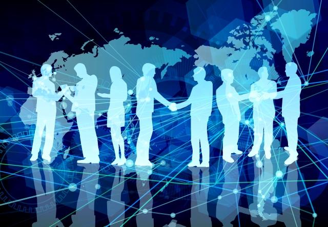 ビジネスマンの契約成立の握手とネットワーク